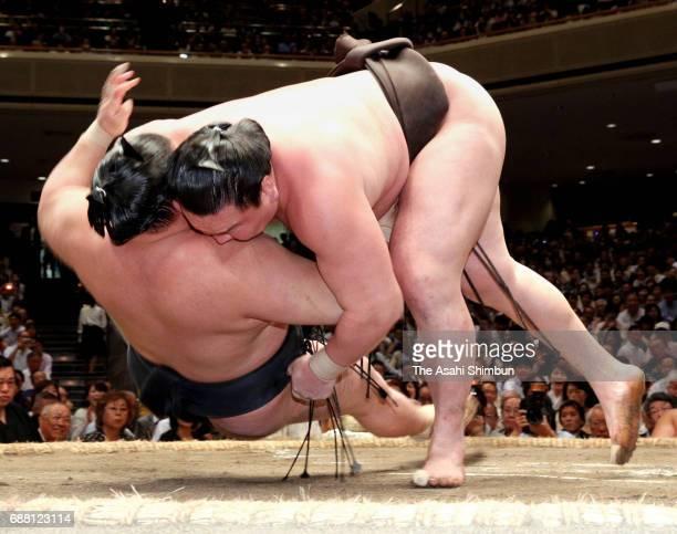 Mongolian yokozuna Hakuho throws ozeki Goeido to win during day eleven of the Grand Sumo Summer Tournament at Ryogoku Kokugikan on May 24 2017 in...