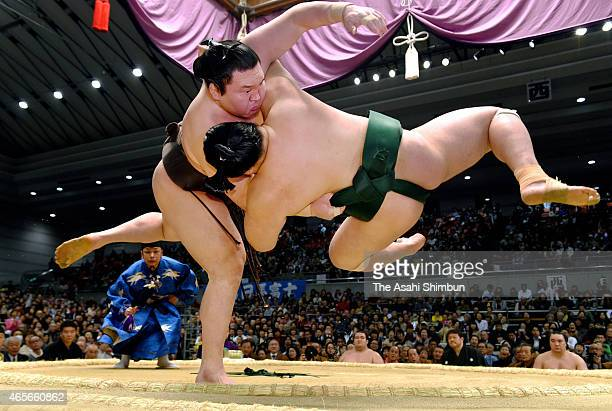 Mongolian yokozuna Hakuho throws Sadanoumi to win during day two of the Grand Sumo Spring Tournament at Bodymaker Colosseum on March 9 2015 in Osaka...
