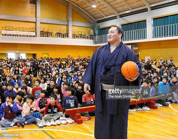 Mongolian yokozuna Hakuho visits Ohara elementary school on November 1 2012 in Kitakyushu Fukuoka Japan Hakuho whose real name is Monkhbatyn...