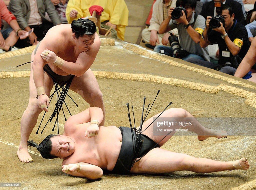 Mongolian yokozuna Hakuho (L), whose real name is Mnkhbatyn Davaajargal throws Ikioi during day two of the Grand Sumo Autumn Tournament at Ryogoku Kokugikan on September 16, 2013 in Tokyo, Japan.