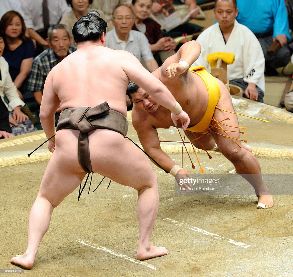 Mongolian yokozuna Hakuho (L), whose real name is Mnkhbatyn Davaajargal and Shohozan compete during day three of the Grand Sumo Autumn Tournament at Ryogoku Kokugikan on September 17, 2013 in Tokyo, Japan.
