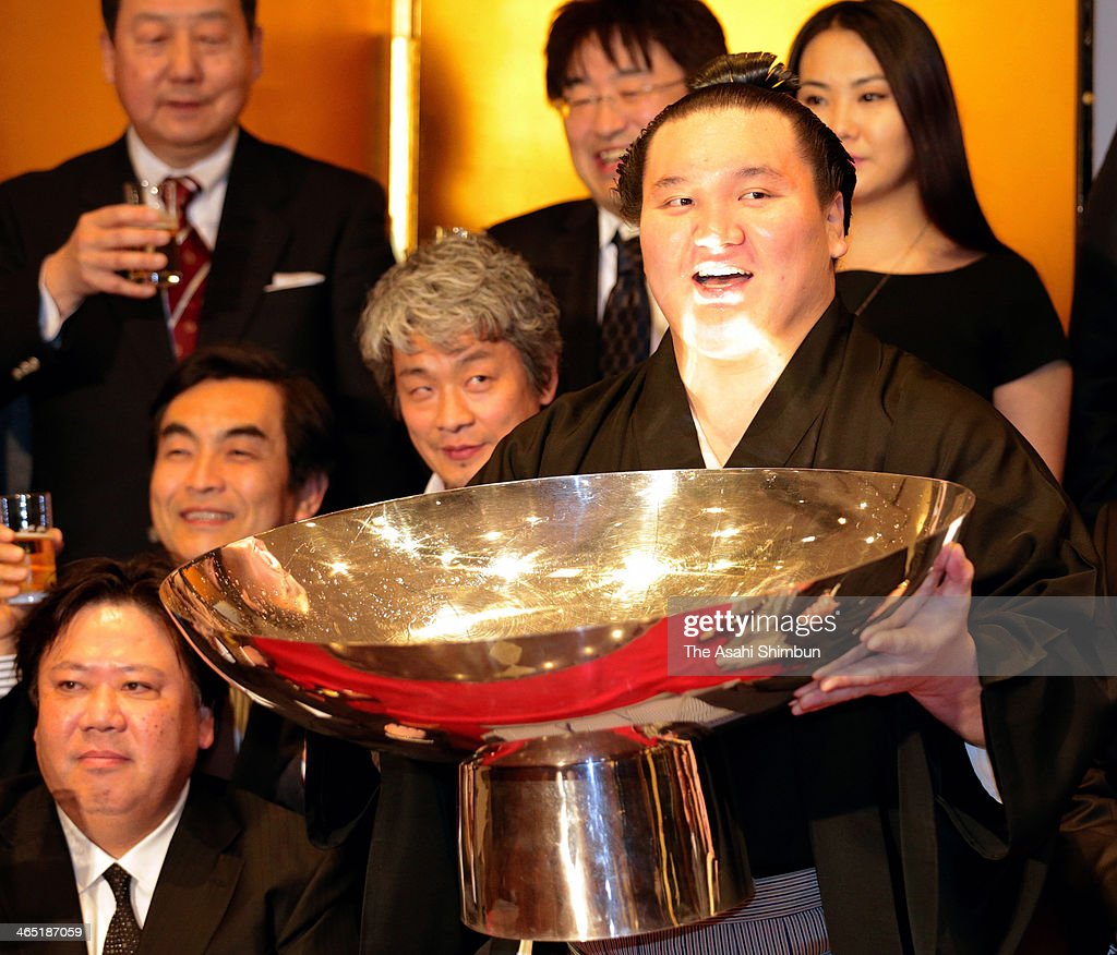 Mongolian yokozuna Hakuho, whose real name is Munkhbat Davaajargal celebrates by drinking Japanese sake after winning the Grand Sumo New Year Tournament on January 26, 2014 in Tokyo, Japan.