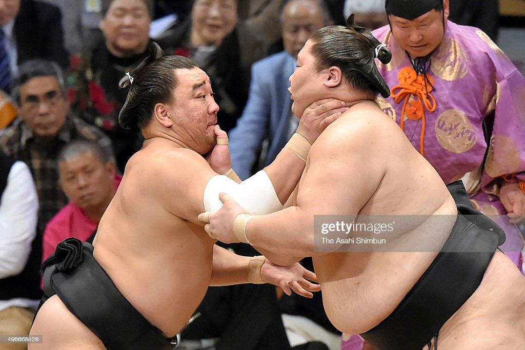 Mongolian yokozuna Harumafuji and his fellow wrestler Ichinojo compete during day four of the Grand Sumo Kyushu Tournament at Fukuoka Convention...