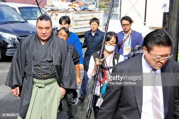 Mongolian Yokozuna Harumafuji and his stabelmaster Isegahama are seen after unable to see Takanoiwa and his stablemaster Takanohana on November 14...