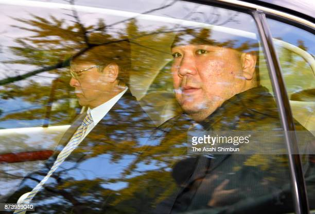 Mongolian Yokozuna Harumafuji and his stabelmaster Isegahama are seen on departure to meet Takanoiwa and his stablemaster Takanohana on November 14...