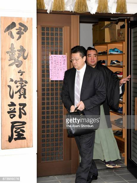 Mongolian Yokozuna Harumafuji and his stabelmaster Isegahama are seen on departure at the temporary stable quarters to meet Takanoiwa and his...
