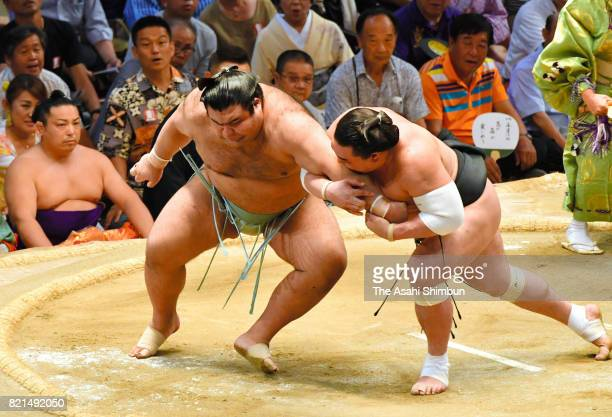 Mongolian yokozuna Harumafuji and ozeki Takayasu compete during day fourteen of the Grand Sumo Nagoya Torunament at Aichi Prefecture Gymnasium on...