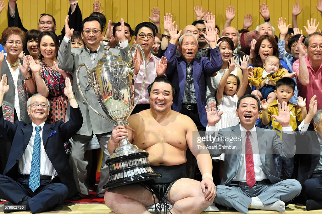 Mongolian yokozuna Harumafuji celebrates with his supporters in the dressing room after winning the tournament during day fifteen of the Grand Sumo...