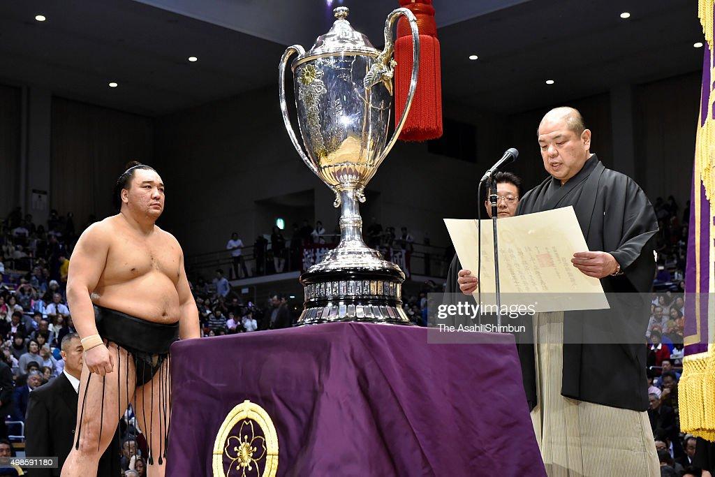 Mongolian yokozuna Harumafuji is seen during the award ceremony after winning the Grand Sumo Kyushu Tournament at Fukuoka Convention Center on...