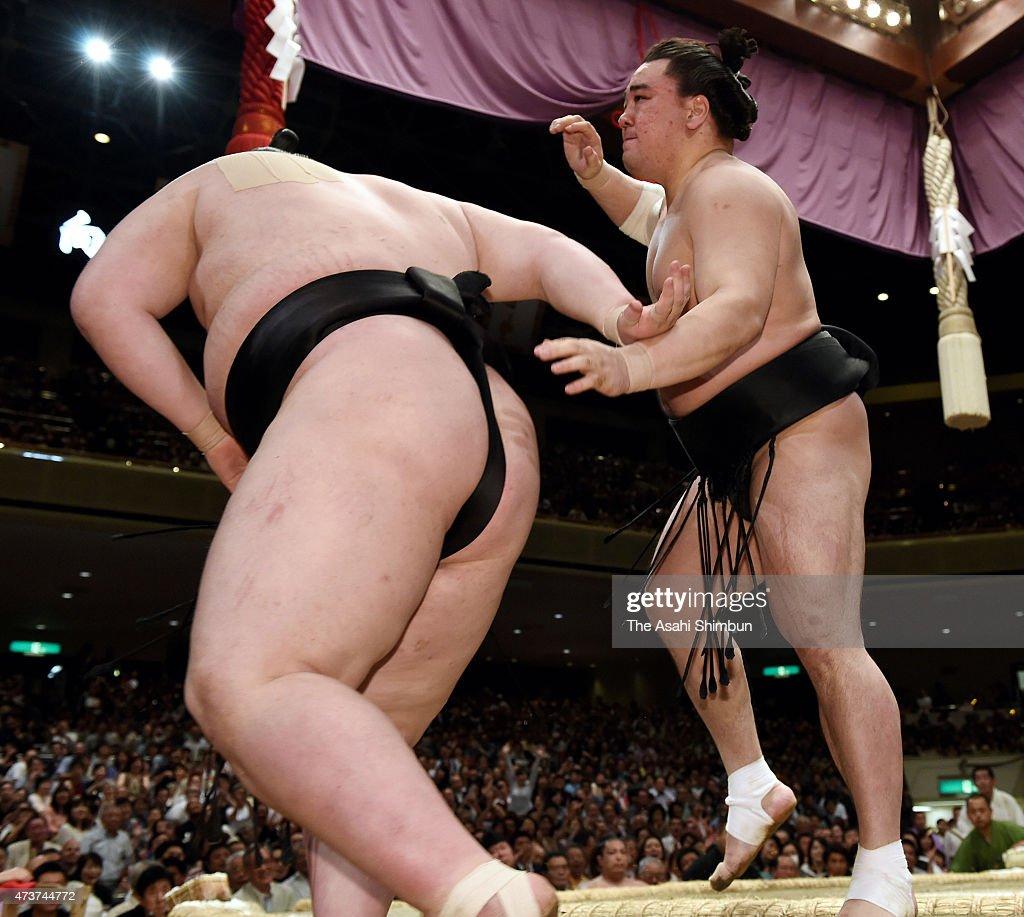 Mongolian yokozuna Harumafuji pushes Ichinojo out of the ring to win in day eight of the Grand Sumo Summer Tournament at Ryogoku Kokugikan on May 17...