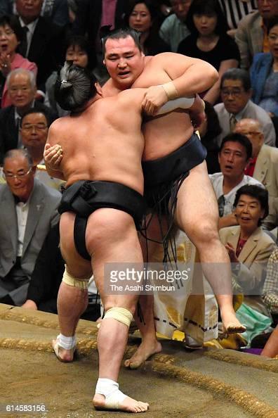 Mongolian yokozuna Harumafuji pushes Mongolian yokozuna Karuryu to win during final day of the Grand Sumo Autumn Tournament at Ryogoku Kokugikan on...