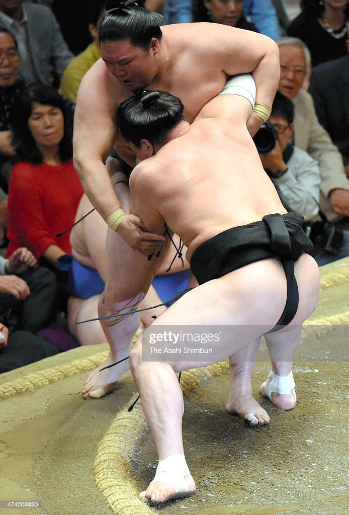 Mongolian yokozuna Harumafuji pushes ozeki Goeido out of the ring to win during day eleven of the Grand Sumo Summer Tournament at Ryogoku Kokugikan...
