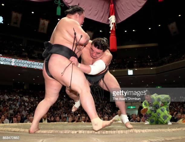 Mongolian yokozuna Harumafuji pushes ozeki Goeido out of the ring to win the tournament in the championship playoff during day fifteen of the Grand...