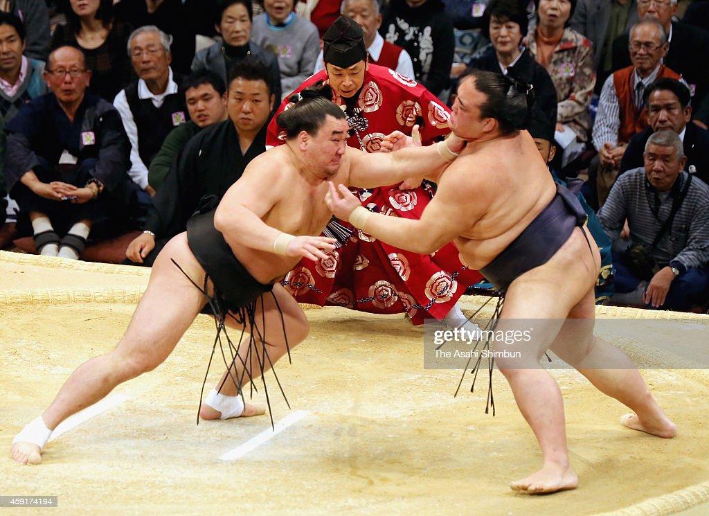 Mongolian yokozuna Harumafuji pushes ozeki Kisenosato out of the ring to win during day ten of the Grand Sumo Kyushu Tournament at Fukuoka Convention...