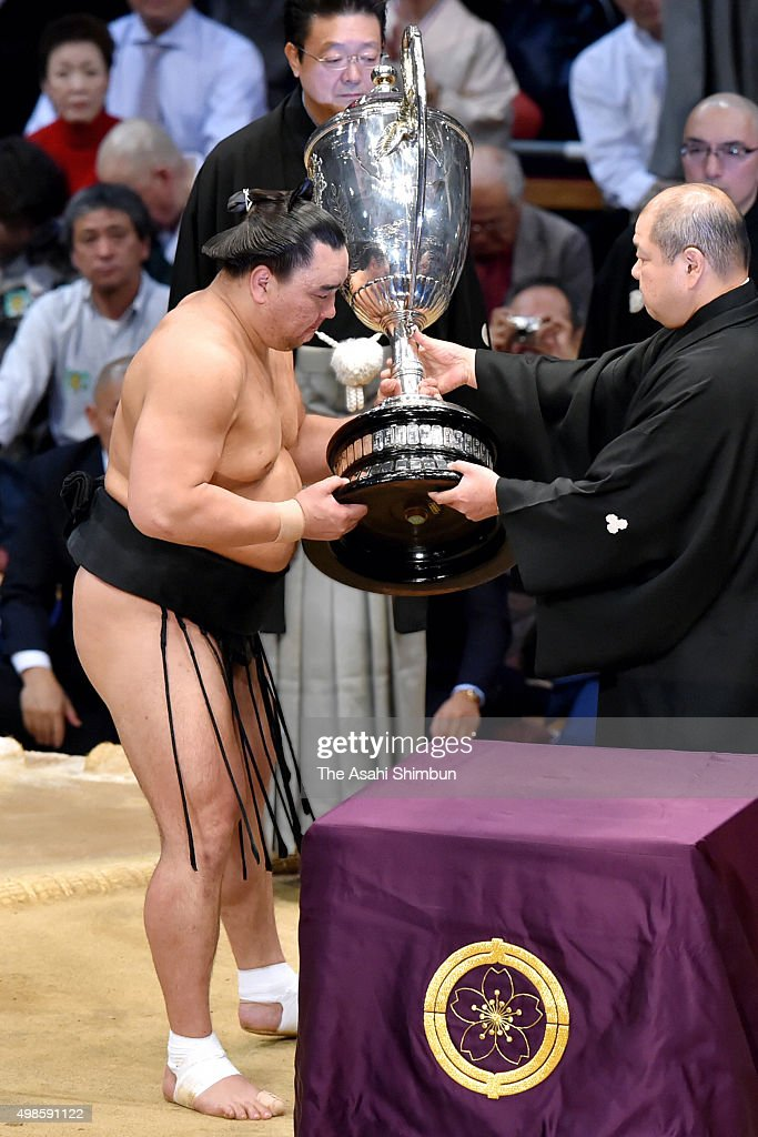 Mongolian yokozuna Harumafuji receives the Emperor's Cup during the Grand Sumo Kyushu Tournament at Fukuoka Convention Center on November 22 2015 in...
