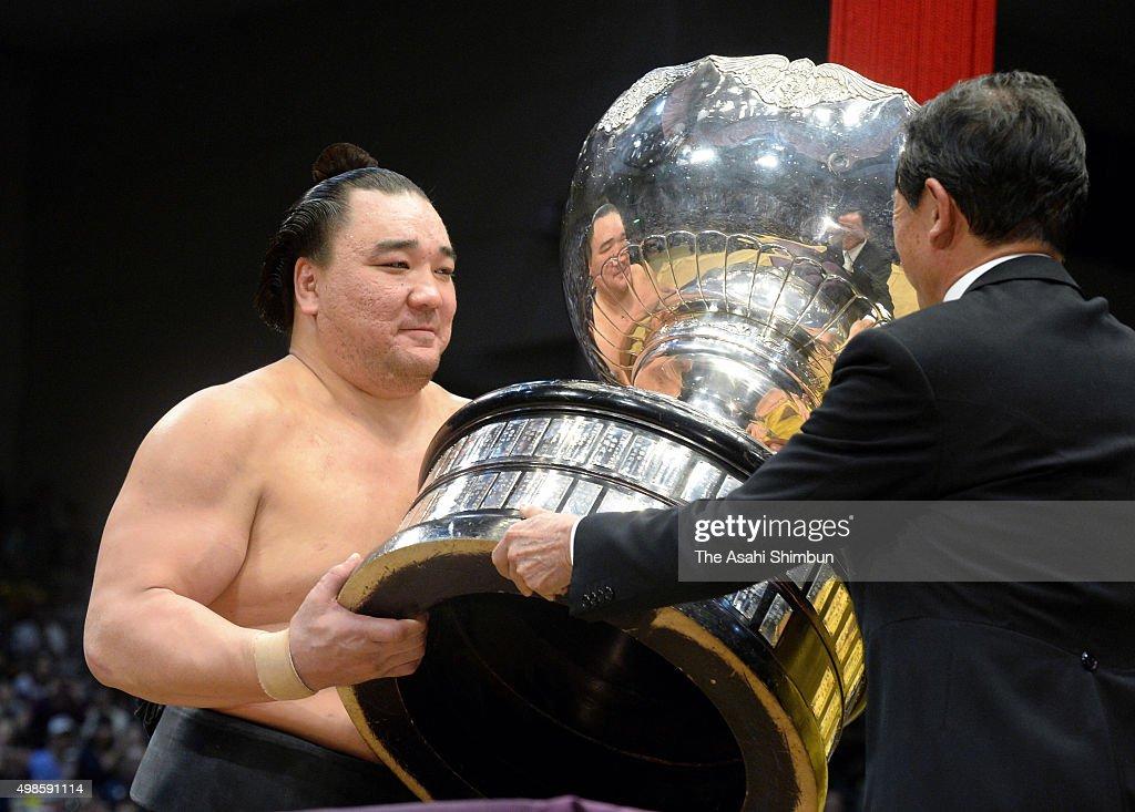 Mongolian yokozuna Harumafuji receives the Prime Minister's Cup after winning the Grand Sumo Kyushu Tournament at Fukuoka Convention Center on...