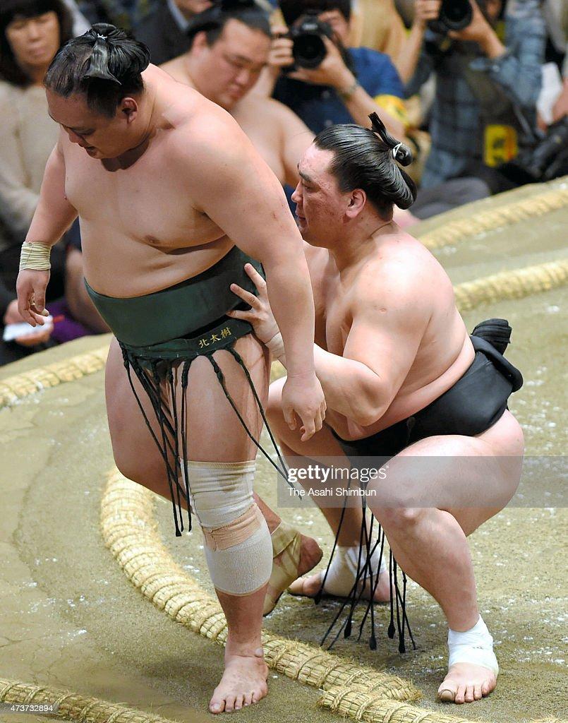 Mongolian yokozuna Harumafuji sends Kitataiju out of the ring to win in day seven of the Grand Sumo Summer Tournament at Ryogoku Kokugikan on May 16...