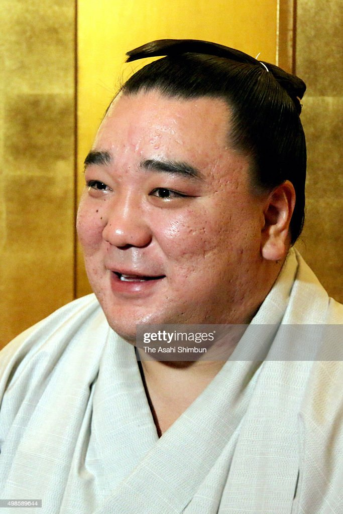 Mongolian yokozuna Harumafuji speaks during a press conference a day after winning the Grand Sumo Kyushu Tournament on November 23 2015 in Dazaifu...