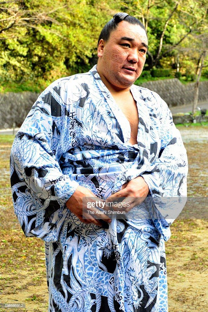Mongolian yokozuna Harumafuji speaks to media reporters on the late Japan Sumo Association President stabel master Kitanoumi after a morning practice...