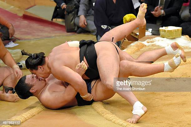 Mongolian yokozuna Harumafuji throws Ikioi to win during day nine of the Grand Sumo Kyushu Tounament at Fukuoka Convention Center on November 16 2015...
