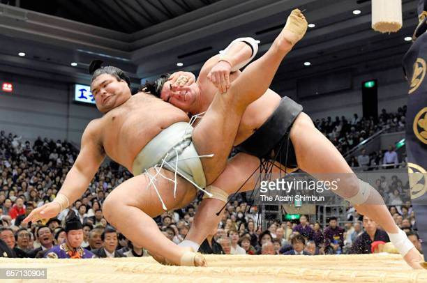Mongolian yokozuna Harumafuji throws sekiwake Takayasu to win during day twelve of the Grand Sumo Spring Tournament at Edion Arena Osaka on March 23...
