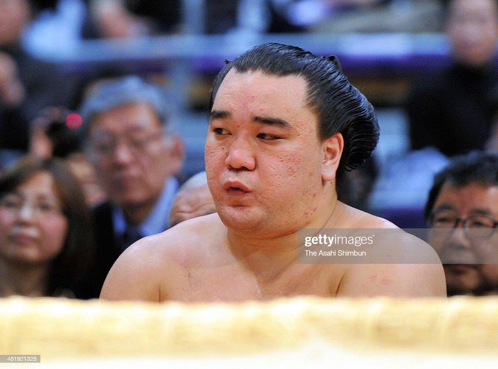 Mongolian yokozuna Harumafuji whose real name is Altangadasyn Khuchitbaatar looks dejected after losing to ozeki Kisenosato during day thirteen of...