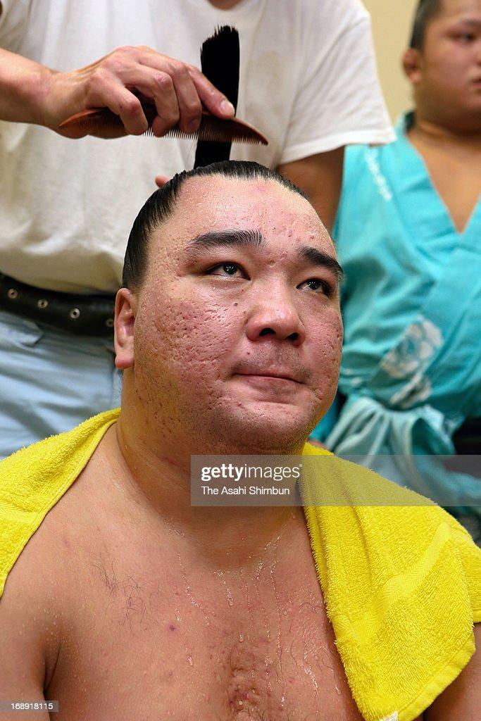 Mongolian yokozuna Harumafuji, whose real name is Davaanyamyn Byambadorj looks on at the dressing room during day five of the Grand Sumo Summer tournament at Ryogoku Kokugikan on May 16, 2013 in Tokyo, Japan.
