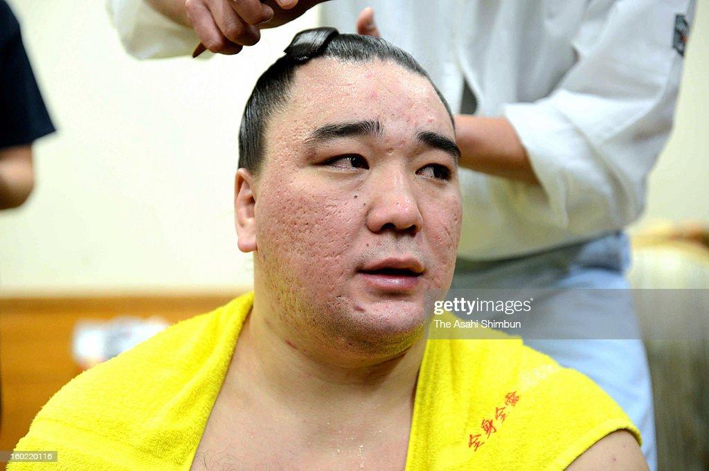Mongolian yokozuna Harumafuji whose real name is Davaanyamyn Byambadorj speaks to media reporters after winning the Grand Sumo New Year Tournament at...