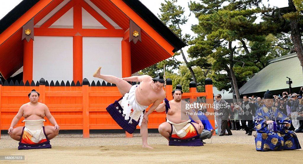 Mongolian yokozuna, sumo grand chamipon <a gi-track='captionPersonalityLinkClicked' href=/galleries/search?phrase=Hakuho&family=editorial&specificpeople=625611 ng-click='$event.stopPropagation()'>Hakuho</a>, whose real name is Monkhbatyn Davaajargal performs the Dohyo-Iri, ring purification ritual at Sumiyoshi Taisha Shrine on March 2, 2013 in Osaka, Japan.