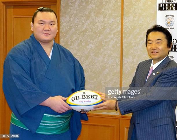 Mongolian yokozuna sumo grand champion Hakuho poses with Higashiosaka City Mayor Yoshikazu Noda during his visit on March 26 2015 in Higashiosaka...