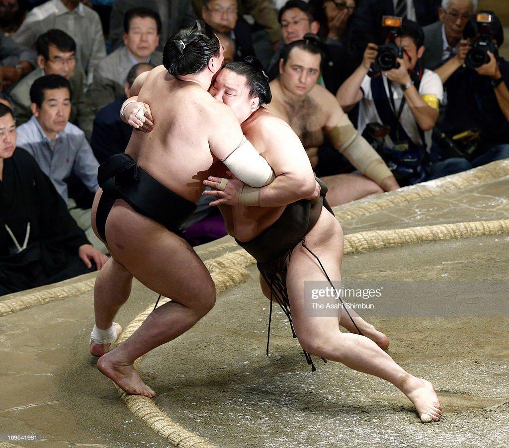 Mongolian Yokozuna sumo's grand champion Hakuho whose real name is Mnkhbatyn Davaajargal pushes his fellow yokozuna Harumafuji whose real name is...