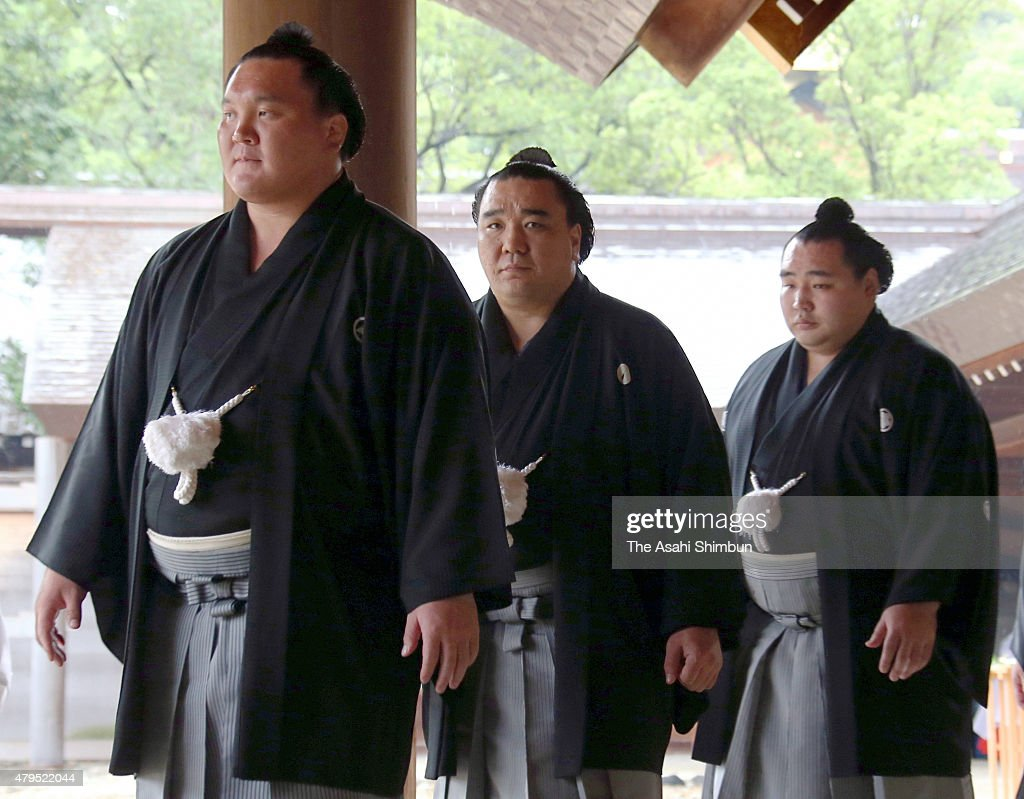 Mongolian yokozunas Hakuho Harumafuji and Kakuryu are seen on arrival at Atsuta Jingu Shrine ahead of the Grand Sumo Nagoya Tournament on July 4 2015...