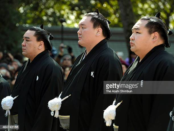 Mongolian yokozunas sumo grand champions Harumafuji Hakuho and Kakuryu are seen during their visit to Sumiyoshi Taisha Shrine ahead of the Grand Sumo...