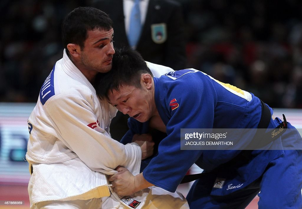 Mongolia's Bolbaatar Ganbat and Georgia's Amiran Papinashvili compete during the under 60kg finals at the2014 Paris Judo Grand Slam tournament on...