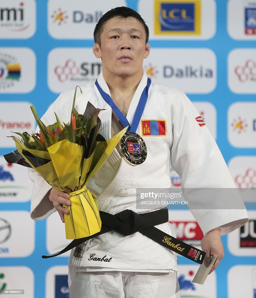 Mongolia's Boldbaatar Ganbat poses on the podium after winning in the 60 kg finals at the 2014 Paris Judo Grand Slam tournament on February 8 2014 in...