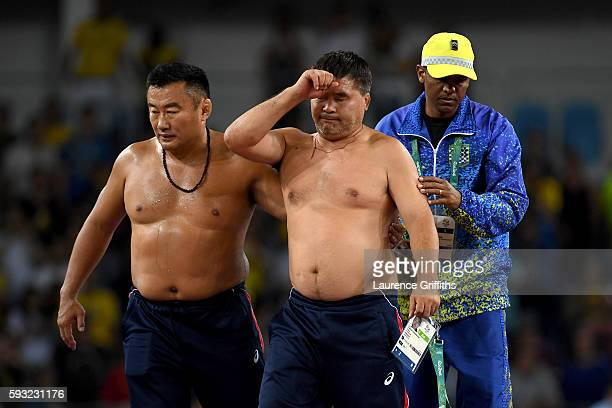 Mongolias coaches protest the judges decision after Mandakhnaran Ganzorig of Mongolia is defeated by Ikhtiyor Navruzov of Uzbekistan in the Men's...