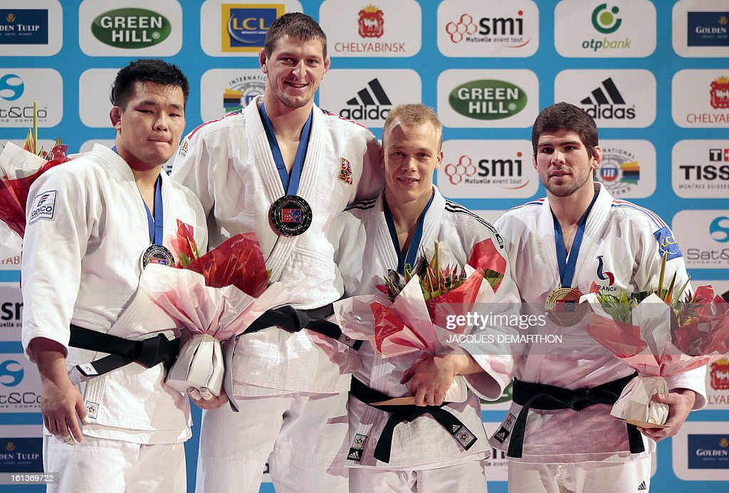Mongolia's silver medalist Temuulen Battulga, Czech gold medalist Lukas Krpalek, and bronze medalists Henk Grol of the Netherlands and Cyrille Maret of France, pose on the podium of the Men -100kg contest of the Paris' Judo Grand Slam tournament on february 10, 2013 in Paris.