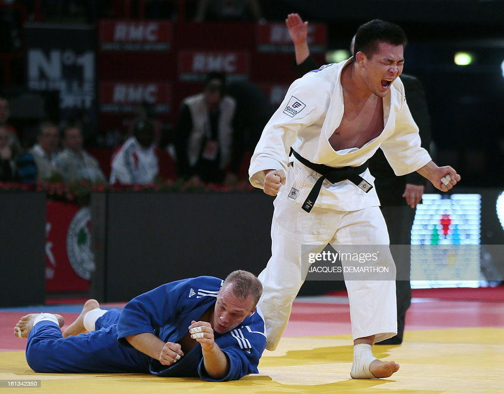 Mongolia's Temuulen Battulga (white) celebrates after beating Netherlands Henk Grol (blue), on February 10, 2013 in Paris, during the semi-finals of the Men -100kg of the Paris Judo Grand Slam tournament.