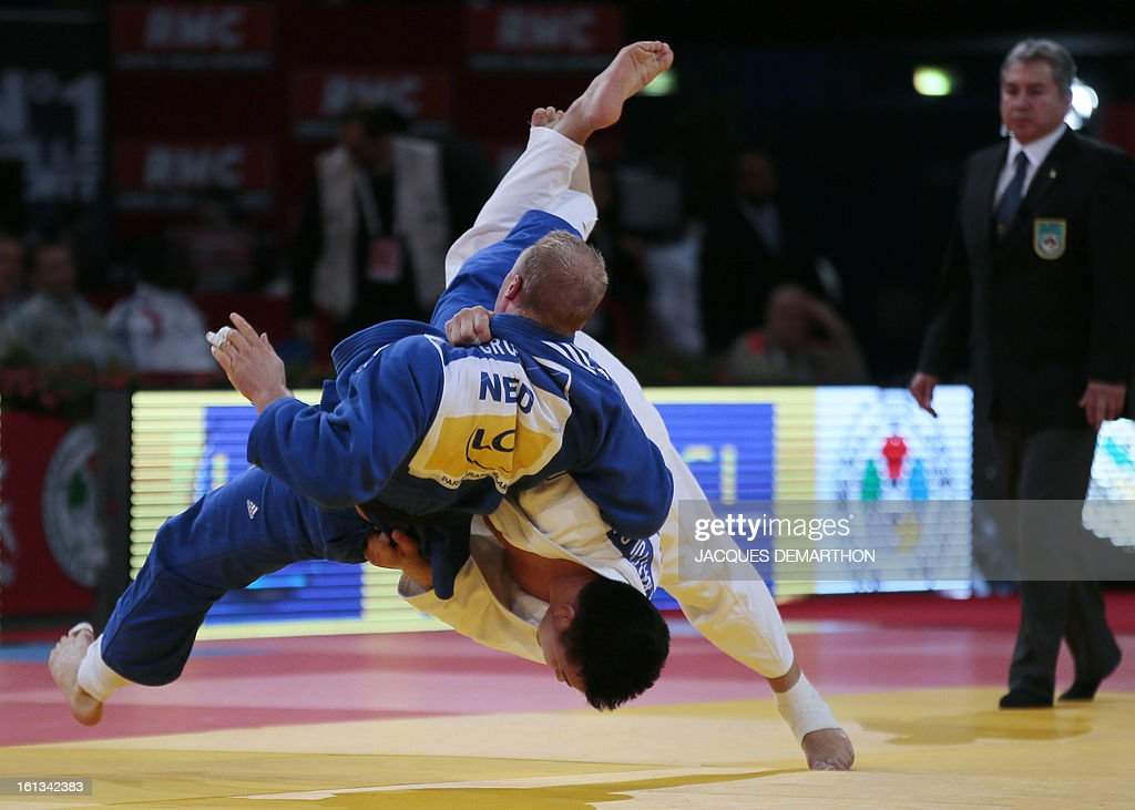 Mongolia's Temuulen Battulga (R) competes against Netherlands Henk Grol on February 10, 2013 in the Men's under 100kg category qualifying fight during the Paris International Judo tournament, part of the Grand Slam, at the Palais Omnisports de Paris-Bercy (POPB). AFP PHOTO / JACQUES DEMARTHON