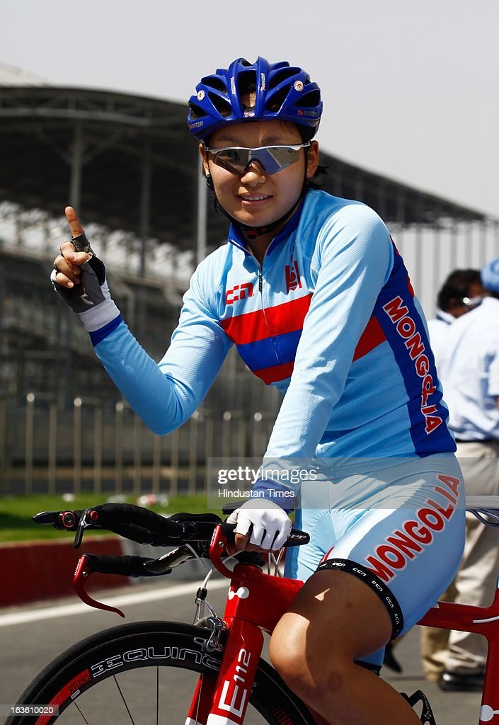 Mongolia's Tuvshinjargal Enkhjargal after winning Gold in the Individual Time Trial- Women Elite Final during the Asian Cycling Championship Road Race at the Buddh International Circuit on March 13, 2013 at Greater Noida, India.