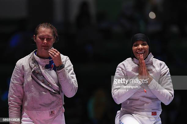 Monica Aksamit and Ibtihaj Muhammad of the United States celebrate after the United States wins the Women's Sabre Team bronze medal match between...