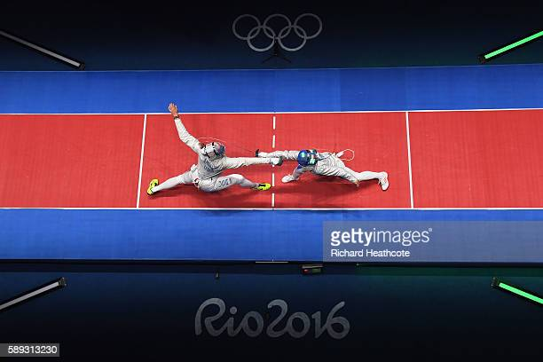 Monica Aksamit of the United States competes against Ilaria Bianco of Italy during the Women's Sabre Team bronze medal match between United States...
