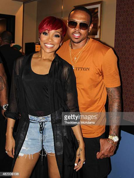 Monica and Shannon Brown at The TM 101 10 year Anniversary Concert at The Fox Theater on July 25 2015 in Atlanta Georgia