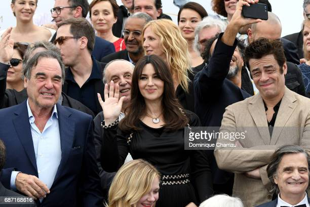 Monica Bellucci and Benicio del Toro attend the 70th Anniversary photocall during the 70th annual Cannes Film Festival at Palais des Festivals on May...