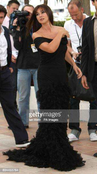 AP OUT Monica Bellucci arrives at a photocall for her new film An Italian History during the 61st Cannes Film Festival at the Palais de Festival in...