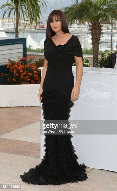 AP OUT Monica Bellucci arrives at a photocall for her new film 'An Italian History' during the 61st Cannes Film Festival at the Palais de Festival in...