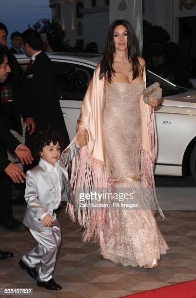 Monica Bellucci arrives with the grandson of owner Telman Ismailov for the opening party of the Mardan Palace hotel in Antalya Turkey