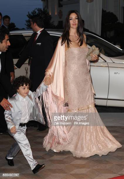 Monica Bellucci arrives with the grandson of owner Telman Ismailov for the opening party of the Mardan Palace hotel in Antalya Turkey PRESS...