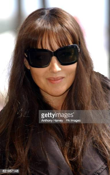 AP OUT Monica Bellucci poses for photographers during the photocall for 'Le Deuxieme Souffle' at the Carlton Hotel during the 59th Cannes Film...