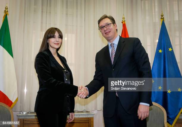 Monica Bellucci shake hands with Aleksandar Vucic Prime Minister of Serbia during their meeting on February 24 2017 in Belgrade Serbia